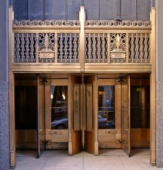 Bronze Art Deco door to the building at 222 North Wells Street in the downtown area of Chicago, Illinois.