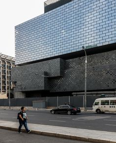 Photographs from Yueqi Jazzy Li reveal a first look at the nearly completed Guardian Arts Center in Beijing by architecture firm Büro Ole Scheeren