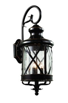 Coastal New England horse and carriage wall lantern. Cross bar frame with rounded seeded glass. Wrought iron wall arm and temple top cap. Finish: Rubbed Oil Bronze Height: 23.25'' Width: 9'' Depth: 12