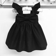 Aleteo negro mangas arco grande simple vestido vestido de