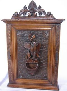 Lovely Antique Black Forest Hand Carved Cabinet.  Would be lovely in a cabin in the woods Or a Country home. Photo via google search.