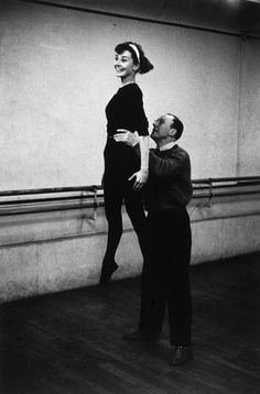 Audrey Hepburn with ballet coach Lucien Legrand, the first dancer and choreographerforthe Paris Opera Ballet, at a dance rehearsal for her filmFunny Face, Paris, France, 1956.Photographs by David Seymour.