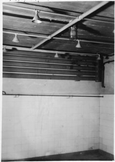 """Inside one of the Gas Chambers at Mauthausen.  The original text reads:  """"This is the gas chamber, note how it looks like a shower room."""" The Nazis went to great pains to keep up the deception that the Jews were being """"resettled"""" or taken into """"protective custody"""" right to the end.  The desperate and frightened people herded into gas chambers like this one, clung to the hope that the Nazis were telling the truth."""