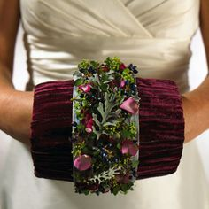 not fond of the bits and pieces look here, but love the concept of the muff anchoring the bouquet.