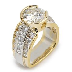 Paragon Collection - 4.14ct Round Brilliant Cut Diamond accented by 2.81ctw side Diamonds set in 18K Yellow and White Gold.