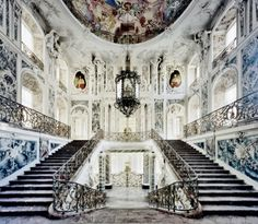 At Augustusburg Castle in Brühl, near Cologne, the architect Balthasar Neumann built one of the most extraordinary of all German Rococo staircases. The architect, in keeping with the style of the time, was concerned less with the beauty of the individual materials than with the overall visual effect when they were brought together, and most of the marble is in fact imitation. No expense was spared, though, on the trompe-l'oeil paintings, created by the most outstanding artists of the day.