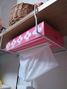 Turn a shelf organizer into a tissue dispenser in the kitchen