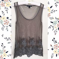 XS gray crochet floral lace mesh tank XS long gray tank from Banana Republic in a sheer mesh fabric, with crochet floral lace detailing on the bottom and silk ribbon edging on the neckline. Worn once. Looks great with dark skinnies or high waisted shorts, and a bralette underneath. Similar to For Love & Lemons, Revolve or Endless Rose styles. Banana Republic Tops Tank Tops