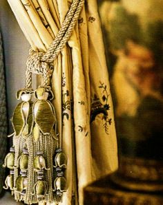 Layered embroidered tassels in olive green and silver, perfect for this curtain.