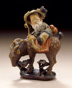 Keisuke (Japan)   Jurojin Mounted on His Stag, late 19th century  Netsuke, Painted wood,
