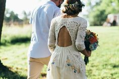 Handmade lacey, embroidered wedding dress! Looks boho and vintage! Love it!!! Plus the floweres in her hair. #weddingdress