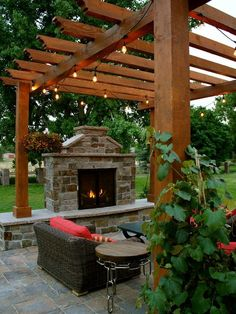 Exterior Design, Exquisite Traditional Back Patio Designs With Charming Wooden Arbor Design Also Rattan Armchair And Traditional Fireplace W...