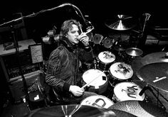 Stewart Copeland in  NYC by Lynn Goldsmith, huge drum kit that shows Stew did not take himself too seriously...