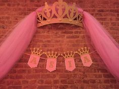 THIS LISTING IS JUST FOR THE BANNER  Decorate your backdrop with this beautiful glitter princess banner. The glitter crowns and letters will catch the light and beautifully complete any princess themed party. Banner features a white scalloped flag layered with a pink flag and topped with a gold glitter crown and gold glitter letter. Can be made with up to 6 letters, if more letters are needed contact me for a quote.  CUSTOMAZABLE: Feel free to message me if you need different colors