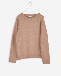 Loose fit classic knitted pullover in soft wool alpaca stretch knit. Soft and calm melange colours in sophisticated hues.  <br><br> - Wool Alpaca mix knit<br> - Loose fit<br> - Generous sleeves<br> <br> The model is 177cm and wears size S.