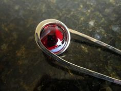 This listing is for one Nickel Silver Hair fork, with swirls of Deep Red mixed with a touch of Black. The reds seem to drip out from it when the light shines through...  I make these hair pins from .051 Nickel silver wire. I cut, bend and then hammer them into their shape...and then add in a ma...