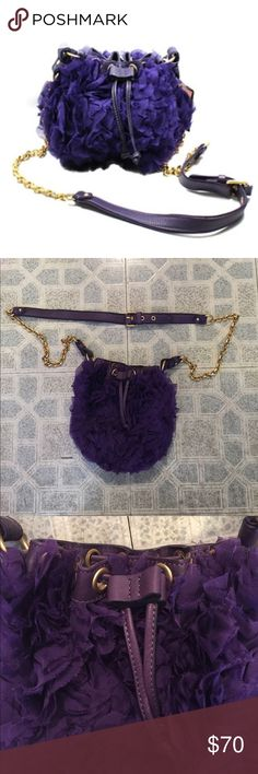 """JUICY COUTURE Pouchette Purple Chiffon Bag """"This crossbody bag is a mix between girly, dainty and perhaps even a bit funky. Drawstring closure. Features silk-chiffon ruffles and leather trim. Gold-tone hardware. Adjustable leather and chain strap."""" *Ships next day* Juicy Couture Bags Crossbody Bags"""