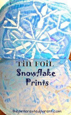 Negative space tin foil snowflake prints . Winter & Christmas arts & crafts for kids. Printmaking ideas