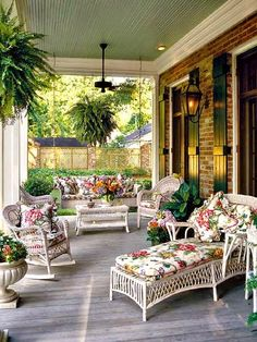 Ask any Southerner what they like most about a house, and they'll probably say the porch. Regardless of whether it's at the back or front, it's simply the favorite place to relax. Here traditional wicker seating and colorful floral cushions welcome you, creating an ambiance that's cheerful Southern comfort. Lovely green ceiling adds calming serenity.