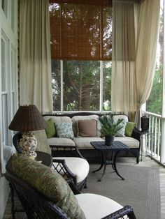lynn...loving the drapery idea...for a very cozy indoor feel..softens up hard lines....for more relaxing feel too..porch decor ideas