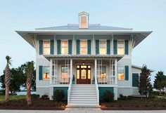 """Coastal Living Showhouse.  Coastal Living Showhouse   The exterior paint color is """"Sherwin-Williams SW2116 Falling Star"""". Trim Paint Color is """"Sherwin-Williams SW7006 Extra White"""".  Shutter Paint Color: """"Sherwin-Williams WW7614 St. Bart's"""". #CoastalLivingShowhouse"""