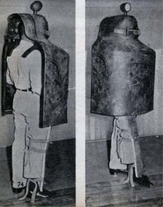 1950's body armor designed to protect Detroit police officers. The police were supposed to fire through the portholes, which were made from bulletproof glass. Other handy features were the spotlight on the top and the 'leggings'. As it's made of steel and weighed 65-lbs, a version with wheels attached was designed for anyone wanting a bit of extra help.