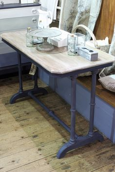 Victorian side table. We love the legs on this table, they remind us of industrial plumbing! I painted them in Grand Illusions Vintage paint in Stockholm (a deep Gustavian blue) and finished the top with paint and stain for a weathered look.