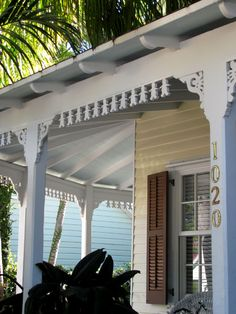 Key West house on 1020 Southard Street has porch gingerbread carved in the shape of gingerbread men.