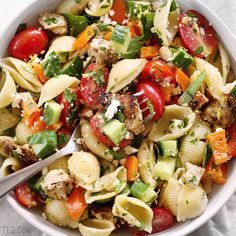 Greek Chicken Pasta Salad is the perfectly refreshing and filling summer meal with its medley of vegetables and tangy lemon garlic dressing. BudgetBytes.com #chicken #pastasalad