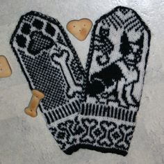 A pair of mittens 'with Boston Terrier. The cat is climbing up a tree.. nice paw print on palm side, thumb is a bone.'
