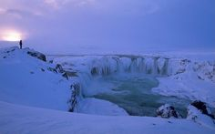 Pale winter light highlights the beautiful ice formations of Goðafoss Falls. The Waterfall of the Gods (Goðafoss) is one of the most popular...