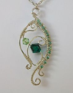 Emerald Crystal and Sterling Silver Eye Pendant by MysticCritterZ, $30.00  This is beautiful.