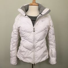 Nike   White Down Puffer Coat Used condition. Does have a few marks here and there from normal wear and because it's white. Wore for one season. Lots of life left! Size does run a little small. Could be for a Small too. Nike Jackets & Coats Puffers