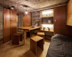 Built by B-ILD in Vuren, The Netherlands with date Images by Tim Van de Velde. B-ILD - BUNKER The project was part of an advertising campaign for the office Famous. A dilapidated bunker was trans. Tiny House Swoon, Tiny House On Wheels, Tiny Living, Living Spaces, Living Walls, Armoire Garage, Bunker Home, Underground Bunker, Safe Room
