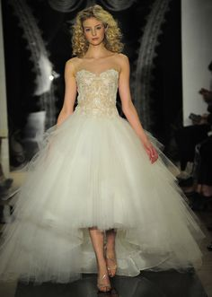 This is a beautiful example of the 2014 hi-low wedding dress trend. So pretty with the layers of tulle and the bodice is so feminine! This is my new favorite!