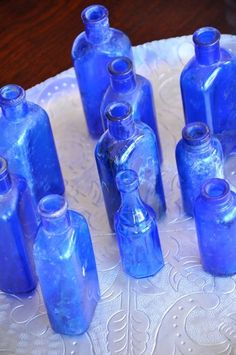 Cobalt Blue Collection glass bottles . Same color glass that the Vicks Vapor Rub used to come in. Now the put it in plastic containers. Blue Glass Bottles, Cobalt Glass, Blue Bottle, Glass Jars, Cobalt Blue, Indigo Blue, Antique Bottles, Bottles And Jars, Antique Glass