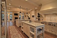 Now that's a kitchen! the cabinetry is flawless.... Dream (sigh)