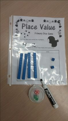 Spring Math Dice Games FREE...I like the container for dice to roll without rolling all over the room