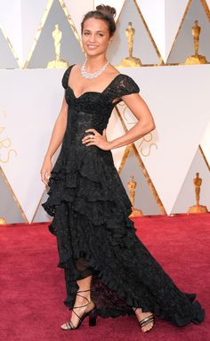 ALICIA VIKANDER in a Louis Vuitton gown and lace-up heels with  Bulgari diamond necklace. OSCARS 2017