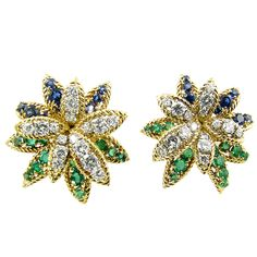 A Fabulous Pair of French Emerald Sapphire Diamond Platinum Flower Earrings | From a unique collection of vintage clip-on earrings at https://www.1stdibs.com/jewelry/earrings/clip-on-earrings/