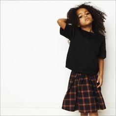 Check skirt with basic black tees