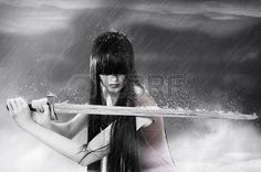 Fashion fantasy portrait of young pretty brunette woman fighter with sword in mist photo