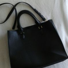 Everyday Large Tote with Double Handles Large Double Handle Tote with shoulder strap in black pebbled imitation leather with gold hardware. Black interior with two sections divided with a zippered pocket. NWT, never used yet! Debating on keeping this trendy tote! Bags Totes