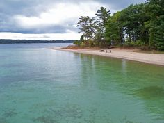 Power Island - Grand Traverse County, 202 acres on the West Arm of Grand Traverse Bay.  9 miles West of downtown Traverse City.  Hiking, Beaches and Picnic areas.