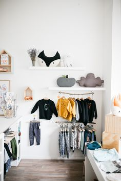 from the lovely blogger Jules at herzundblut.com // monkind shop design, clouds, wood clothes rail, fox, house shelves, gretas schwester