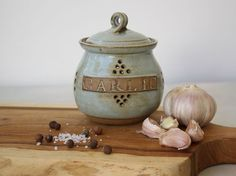 Ceramic garlic keeper, garlic jar, garlic crock, garlic canister, grey jar, jar with lid, kitchen storage, housewarming gift, chef gift  This ceramic garlic keeper will make a nice addition to your kitchen. This container allows you to store your open garlic and cloves in a decorative jar on the counter. Your garlic will be fresh and ready when you want to use it.  Dimensions: Diameter: 4 (10cm) Height: 4 1/2 (11.5cm)   All of my pots are made from a high-firing stoneware, (1220 C /...