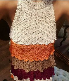 Sleeveless crochet lace top in layered scalloped color bands.