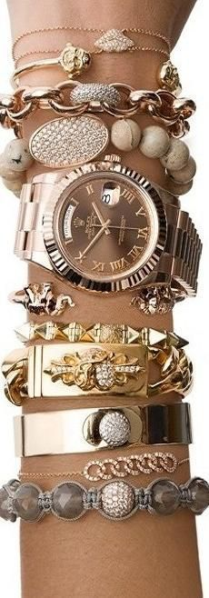 nice Rolex watch and bracelet stack