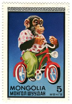 Mongolian postage stamp: chimp on bicycle