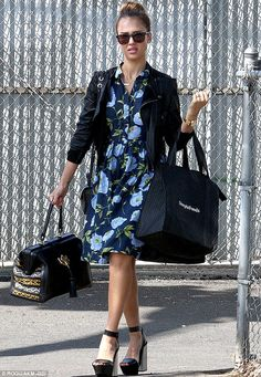 Lovely in layers: Jessica Alba kept her slim figure covered up in a floral frock, black jacket and several bags as she headed into The Honest Company offices in Santa Monica on Thursday